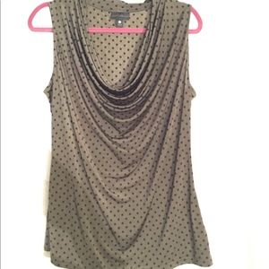 Olive green sleeveless top with black polka dots.